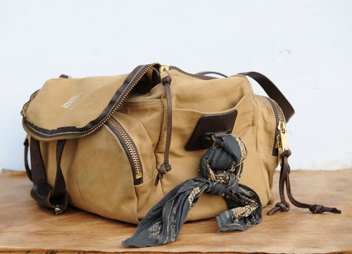 Filson - Sportsman's Bag C. C. Filson moved to the small city of Seattle, Washington in the 1890's and his timing couldn't have been better. By 1897, the Great Klondike Gold Rush was on, and thousands of fortune hunters were stampeding into Seattle, headed north. In 1897, Filson opened C.C. Filson's Pioneer Alaska Clothing and Blanket Manufacturers, specializing in goods to outfit the stampeders to the Klondike Gold Rush. Stories of harrowing experiences in the Yukon were widely reported and it was for these terrible conditions that Filson designed his goods. He owned his own mill and manufactured Mackinaw clothing, Mackinaw blankets and knit goods, as well as selling boots, shoes, moccasins and sleeping bags specially designed for the frigid North. Filson kept in close contact with his customers, improving his goods to meet their specific needs. The stampeders depended on Filson. In that era, clothing wasn't a matter of choice, but of survival. Today, Filson stands by these traditions and continues to outfit the world with indestructible and time honored goods. Photo via RedWing1905