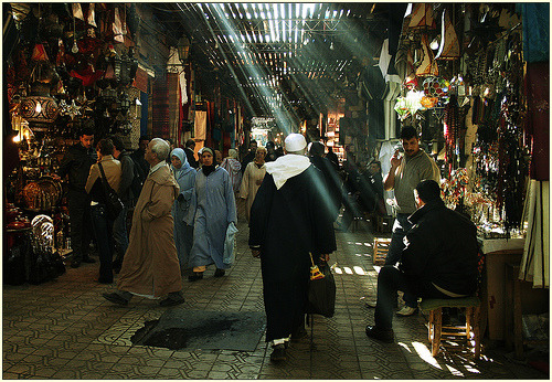 Light streaming through the rafters above in the souk | Marrakech, Morocco. le souk ! (by …cathzilla) View my photos from Morocco here.