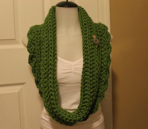 Green Pretty Petal This scarf was designed and crocheted by me with lots of love. The button(s) and chain(s) are from a stash of buttons my grandmother owned.