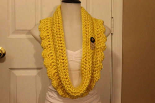 Yellow Pretty Petal This scarf was designed and crocheted by me with lots of love. The button(s) and chain(s) are from a stash of buttons my grandmother owned.