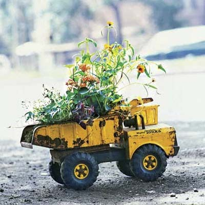 Give your kid's castoff a new life in the garden. Choose toys that'll weather well and ones with dirt-friendly containers, like this Tonka metal dump truck.  (via Toy Planter | Turn Salvaged Junk Into Garden Ornaments | This Old House)