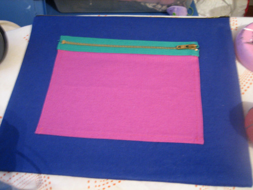 Finishing up this color block clutch…I love the combo of colors: blue, magenta, and bright green zipper with gold teeth.