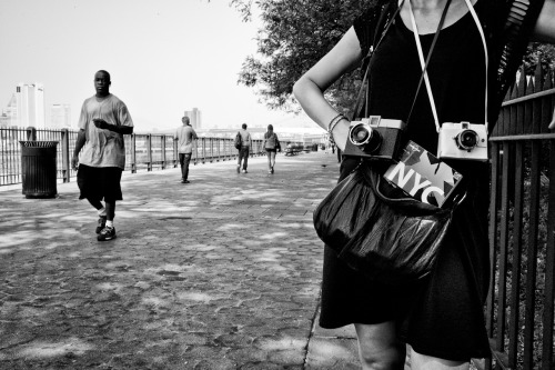 #NYC: #Lomo girl will shoot you to death. (NYC, NY, septembre 2011. Leica M9, Summilux M 35mm f1.4 asph; iso 800, f16, 1/125 s.)