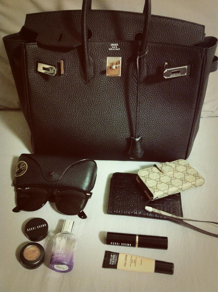 offtherust:  My mom's birkin bag (very old but clean) and my definitely necessary stuff (Ray Ban sunnies/ Gucci iphone case/ Bobbi Brown creamy concealer / Mac eyeshadow-woodwinked / The Body Shop white musk parfum / Bobbi Brown foundation stick / MakeUpForever full cover)
