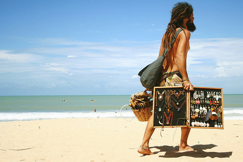 This photo was taken on a beach in Brazil! If you travel to beaches in Latin America, you often see beach sellers (ex. jewelry, juices, or ice-cream)