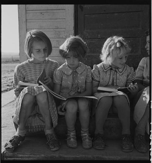 Girls of Lincoln Bench School study their reading lesson.  Near Ontario, Malheur County, Oregon, 1939. Photo by Dorothea Lange