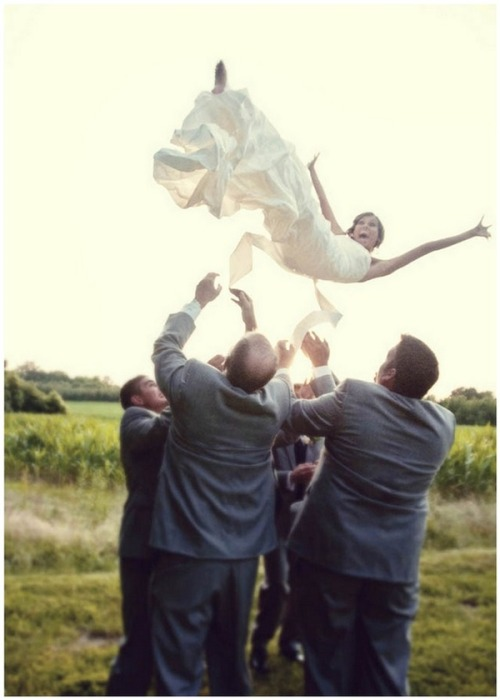 I love when brides are ready to have some fun with their wedding photos. This is one of my favorites; what a classic picture! Don't be afraid to take a risk, the photos will be well worth it! Xoxo, Sarah
