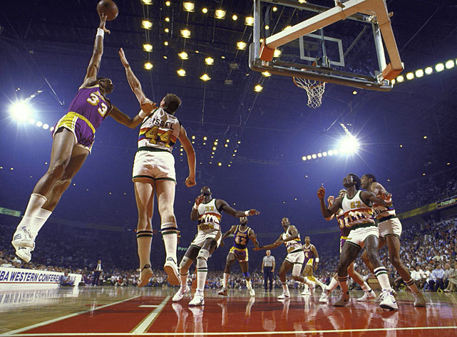 Lakers center Kareem Abdul-Jabbar taking a sky hook over Nuggets forward Dan Issel during a 1985 Denver-Los Angeles game. This year's Lakers squad is off to a 12-9 record, good enough for the No. 9 spot in this week's NBA Power Rankings. Denver (14-6) comes in at No. 5. (Andy Hayt/SI) ROBSON: Heat, Bulls hold down top spots in this week's Power Rankings
