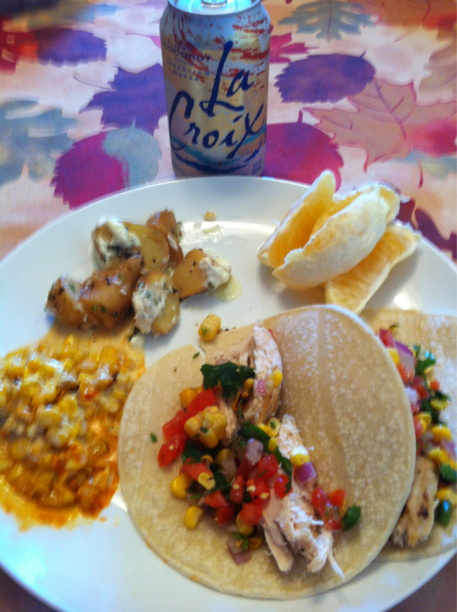 Lunch. Leftover rotisserie chicken on white corn tortillas with pico. Side of corn and potatoes. Half a Mars orange from my Greenling co-op. Coconut La Croix.