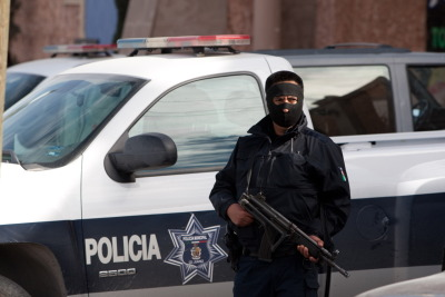 nationalpost:  Drug cartel death threats force police in Mexico's most violent city into hidingSome 2,000 police are hunkering down in hotels in Mexico's most violent city of Ciudad Juarez after a drug gang threatened to kill an officer per day if their chief refused to resign.Eleven police officers, including four commanders, have already been killed in the city across from El Paso, Texas, since the start of the year.The city's mayor this week ordered police to use several local hotels as temporary barracks to protect themselves from attacks on the way home from work in the city at the heart of Mexican drug violence that has left 50,000 dead in five years. (Photo: Jesus Alcazar/AFP/Getty Images)