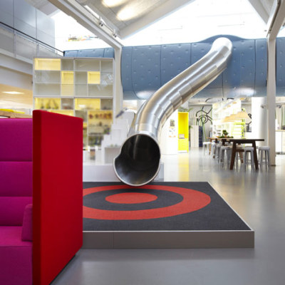 flavorpill:  There's a SLIDE in the LEGO office!