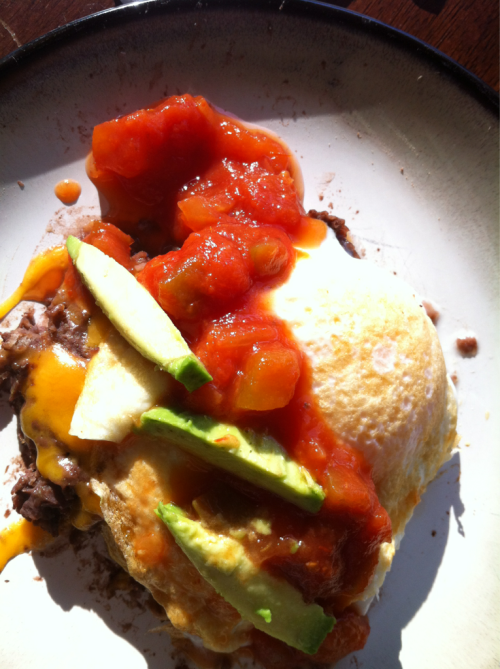 Breakfast Refried black beans, cheese, fried egg, salsa and avocado.   Love this combo- eggs and black beans.