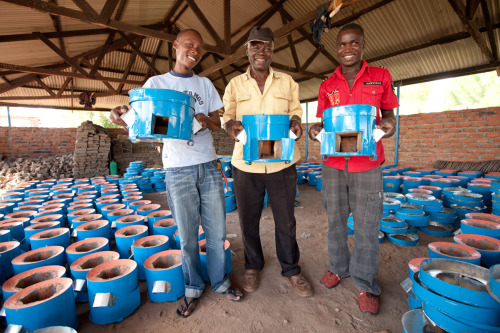 Hassan Opio, John Nagwara, and Kondu Kalifan all proudly hold the charcoal-efficient stoves they make in their Ugandan factory. These stoves are then sold by women entrepreneurs and help families in the local community. Learn more at http://theadventureproject.org.