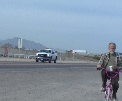 A stroll through buckeye az  A crack head on a little girls bike in the middle of no where now I'm just a little confused where did this bike come from? What happen to the little girl? Where does he get his crack from? So many questions! Man I would love to pick what's left of this guys brain?