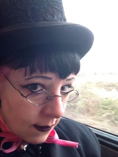 Traveling Goth! I'm on the train and running away to PDX for a few days, wheee! However, Pete and Clovis are keeping an eye on things at home, so don't think you can get away with anything, Seattle …