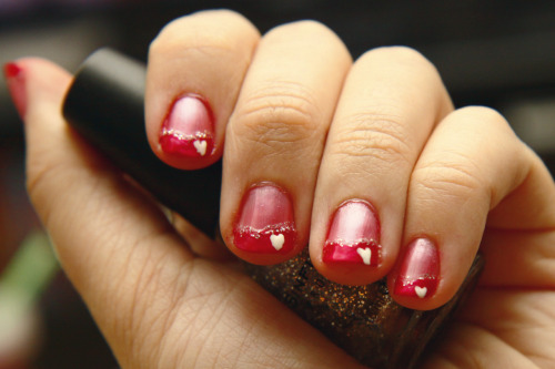 I just painted my nails with a valentine's day design. :)
