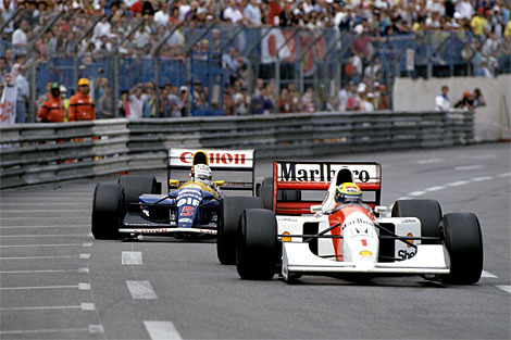 mp45b:  Senna Mansell 1992 Monaco Grand Prix by Brawnfan on Flickr.  Ayrton Senna in the midst of one of the finest displays of defending Formula One has ever seen. After picking up a puncture, Championship leader Nigel Mansell, driving in the beyond dominant FW14B, was behind reigning world champion Ayrton Senna. For the final laps, despite having the better handling car, with a better engine, with fresher tyres, Nige could find no way past the wiley Senna using every inch of the narrow Monaco street circuit to his advantage.