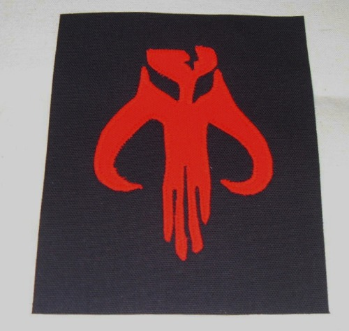 here's the mandalorian patch you can buy it here: http://www.etsy.com/listing/92009378/mandalorian-patch-boba-fett-large-free