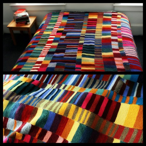 DIY Colorful Knit Blanket. No pattern, no pressure. Just use up your yarn and knit scarves using the garter stitch (knit every row) and seam them together. A good post on knitting what you love, and more directions at Completely Cauchy here.