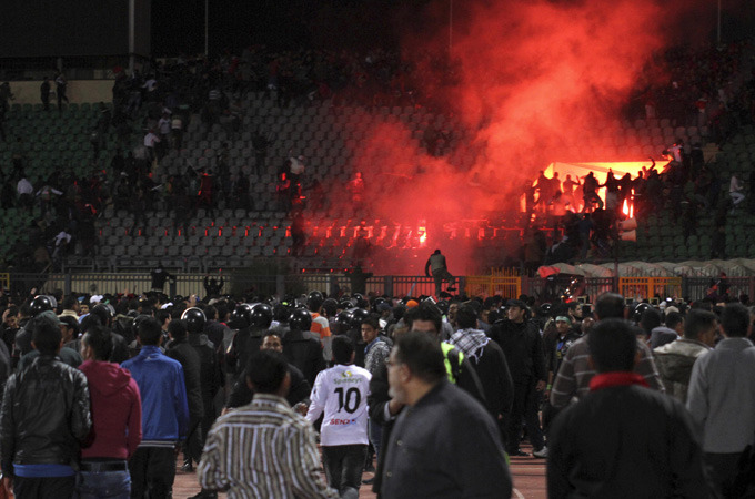 Many dead in Egyptian football riot | Troops deployed on streets of Port Said after clashes between rival fans leave 74 people dead and hundreds injured.