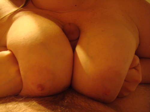 bigboobiesbasement:  My cock being smothered by her big awesome tits. I love how her hands are forming fists to push her big tits together.  I bet it feels great to slide your cock between her massive breasts and even more amazing to shoot your cum all over them! Thanks for your submission, Call!