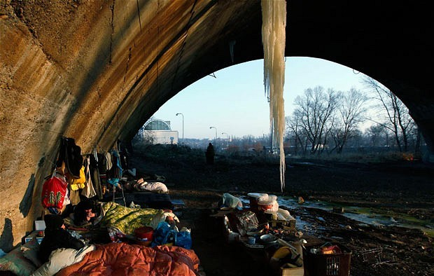 Prague, Czech Republic Homeless people brave low temperatures as they sleep under a bridge with a huge icicle hanging off it, in the Liben district. More than 60 people have died in a cold snap across Eastern Europe. (via Telegraph)