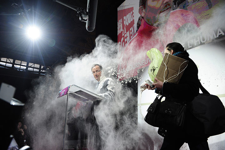 Paris, France A woman throws flour on François Hollande, the Socialist party candidate for the 2012 presidential elections (via guardian.co.uk)