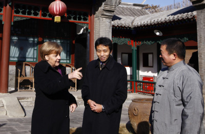 EAST MEETS WEST Angela Merkel, Germany's chancellor, meets locals in Beijing. Merkel is on a two-day visit to China during which she is expected to discuss plans to tackle the eurozone crisis and push China to support the EU oil embargo on Iran.