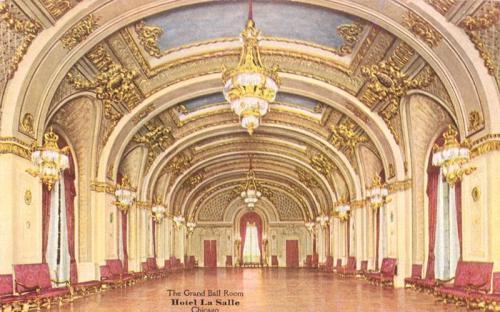 "This is the Grand Ballroom for the LaSalle Hotel, at 10 N. LaSalle Street in Chicago, around 1912.  'Abdu'l-Baha spoke here on May 2, 1912, to the Federation of Women's Clubs.  From his talk: ""To accept and observe a distinction which God has not intended in creation is ignorance and superstition. The fact which is to be considered, however, is that woman, having formerly been deprived, must now be allowed equal opportunities with man for education and training. There must be no difference in their education. Until the reality of equality between man and woman is fully established and attained, the highest social development of mankind is not possible. Even granted that woman is inferior to man in some degree of capacity or accomplishment, this or any other distinction would continue to be productive of discord and trouble. The only remedy is education, opportunity; for equality means equal qualification. In brief, the assumption of superiority by man will continue to be depressing to the ambition of woman, as if her attainment to equality was creationally impossible; woman's aspiration toward advancement will be checked by it, and she will gradually become hopeless. On the contrary, we must declare that her capacity is equal, even greater than man's. This will inspire her with hope and ambition, and her susceptibilities for advancement will continually increase. She must not be told and taught that she is weaker and inferior in capacity and qualification. If a pupil is told that his intelligence is less than his fellow pupils, it is a very great drawback and handicap to his progress. He must be encouraged to advance by the statement, ""You are most capable, and if you endeavor, you will attain the highest degree."" Promulgation of Universal Peace"