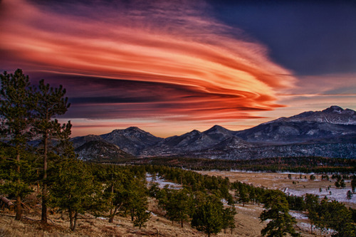 discoverynews:  Rocky Mountain Sunset SurpriseThis spectacular, multi-hued formation of lenticular clouds was observed soon after the sun set over Rocky Mountain National Park near Estes Park, Colo., on Jan. 5. keep reading