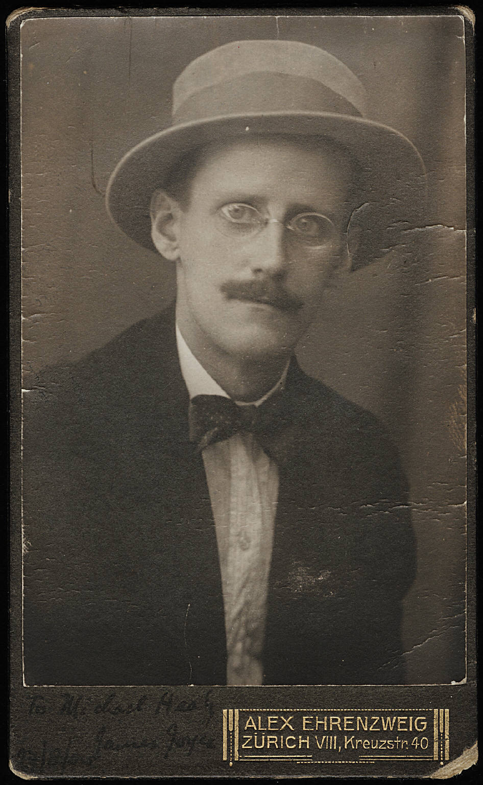 "i12bent:  James Joyce's Dubliners is his first substantial work - a collection of 15 short stories, first published in 1914… ""The Dead"" is the last and perhaps best of these stories, and ends like this: ""A few light taps upon the pane made him turn to the window. It had begun to snow again. He watched sleepily the flakes, silver and dark, falling obliquely against the lamplight. The time had come for him to set out on his journey westward. Yes, the newspapers were right: snow was general all over Ireland. It was falling on every part of the dark central plain, on the treeless hills, falling softly upon the Bog of Allen and, farther westward, softly falling into the dark mutinous Shannon waves. It was falling, too, upon every part of the lonely churchyard on the hill where Michael Furey lay buried. It lay thickly drifted on the crooked crosses and headstones, on the spears of the little gate, on the barren thorns. His soul swooned slowly as he heard the snow falling faintly through the universe and faintly falling, like the descent of their last end, upon all the living and the dead."" ― James Joyce, The Dead - from  Dubliners  Photo of Joyce by Alex Ehrenzweig, Zürich - 1915"