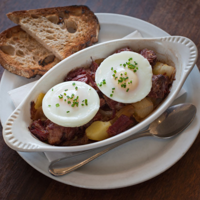 House-cured corned beef and hash with poached eggs and toasted levain at Caffe 817, Oakland, CA.