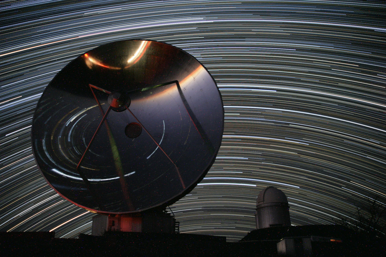 La Silla Star Trails North and South Fix your camera to a tripod and you can record graceful trails traced by the stars as planet Earth rotates on its axis. If the tripod is set up at ESO's La Silla Observatory, high in the Atacama desert of Chile, your star trails would look something like this. Spanning about 4 hours on the night of January 24, the image is actually a composite of 250 consecutive 1-minute exposures, looking toward the north. The North Celestial Pole, at the center of the star trail arcs, is just below the horizon in this southern hemisphere perspective. In the foreground, the polished 15-meter diameter dish antenna of the Swedish-ESO Submillimeter Telescope (now decommissioned) shows star trails toward the south by reflection. Sweeping around the South Celestial Pole, the distorted arcs of those stars appear underneath the southern horizon in the focusing dish's inverted view. Right of the dish is the dome of the observatory's 3.6 meter telescope, home to the planet hunting HARPS spectrograph.