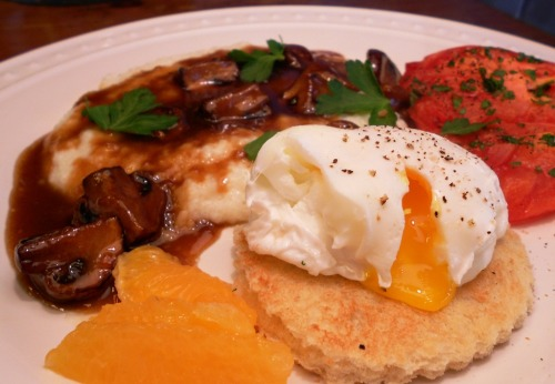 prettygirlfood:  Poached egg, grits w/mushroom red-eye gravy, broiled tomatoes.