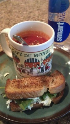 deli shmeli 1cup v8 tomato basil soup (seasoned with crushed red pepper, oregano and black pepper) 1 grilled 3 cheese!  - wheat bread  - goat cheese  - fat free cheddar  - panela cheese  - spinach