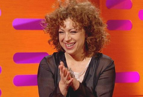 "Alex Kingston Hints River Song May Return On 'Doctor Who'  During the filming of this upcoming weekend's 'The Graham Norton Show,' Alex Kingston was asked if she would be reprising her role as the sassy time travelling semi –companion of the good Doctor. ""You may see her again,"" she insinuates, ""Who knows? Let's just say, 'Upstairs Downstairs' and 'Doctor Who' don't film at the same time,"" referring to her stint as Dr Blanche Mottershead on the British show 'Upstairs Downstairs.' Kingston does know more than what she reveals as, in true River Song style, showrunner Steven Moffat had told her before filming started last season who her parents were and she kept it to herself during filming with the other cast members. ""I knew… for the whole of the last series. (The other actors) didn't know and they were constantly trying to get it out of me. They discovered it in that episode ('A Good Man Goes to War') when they read the scripts."""