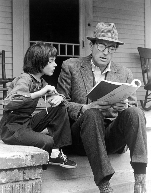 sylviascarlett:  Gregory Peck and Mary Badham review the script for the film, To Kill a Mockingbird, on the set of the film, 1962.