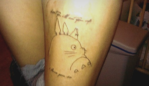 My first tattoo :3 'Don't Go I'll Eat You Up, I Love You So' and Totoro c: