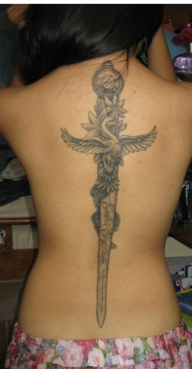 fuckyeahtattoos:  Healed! The Sword of Gryffindor done by the tremendously talented Toby Shipman (http://www.tobyshipman.com/). Harry Potter's the best thing that's happened to my world, alright?