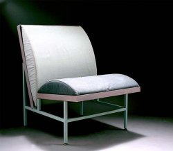 glyphs:  Sottsass Associati. 'Sacher' easy chair and table, 1981. H. 84,5 cm; 63,5 x 77 cm. Made by Driade, Milan. Square steel, wood, blue, mauve and grey textile upholstery