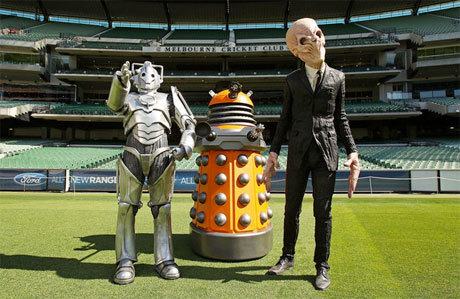 A Dalek, A Cyberman And A Silence Walk Into A Cricket Club… via Anglophenia:  Have no fear, this is neither an invasion by three of the nastiest species in the Whoniverse or an opportunity for alien tourism (although it does look for all the world like the Cyberman is pointing out a fascinating piece of architecture, does it not?). This is a publicity shot for a live appearance this weekend (for the first time outside the UK) in Melbourne, Australia, by three Doctor Who villains who have teamed up with the Melbourne Symphony Orchestra for an evening of Who-related music – the Doctor Who Symphonic Spectacular – at Plenary Hall.