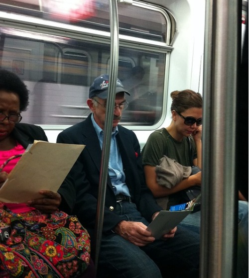 Oh hey, it's Maggie Gyllenhaal on the subway. Livin' it up with the 99%.