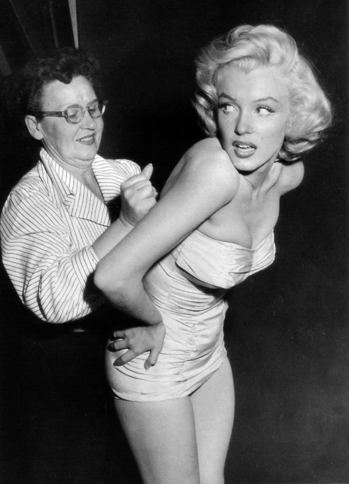 Marilyn gets squeezed.