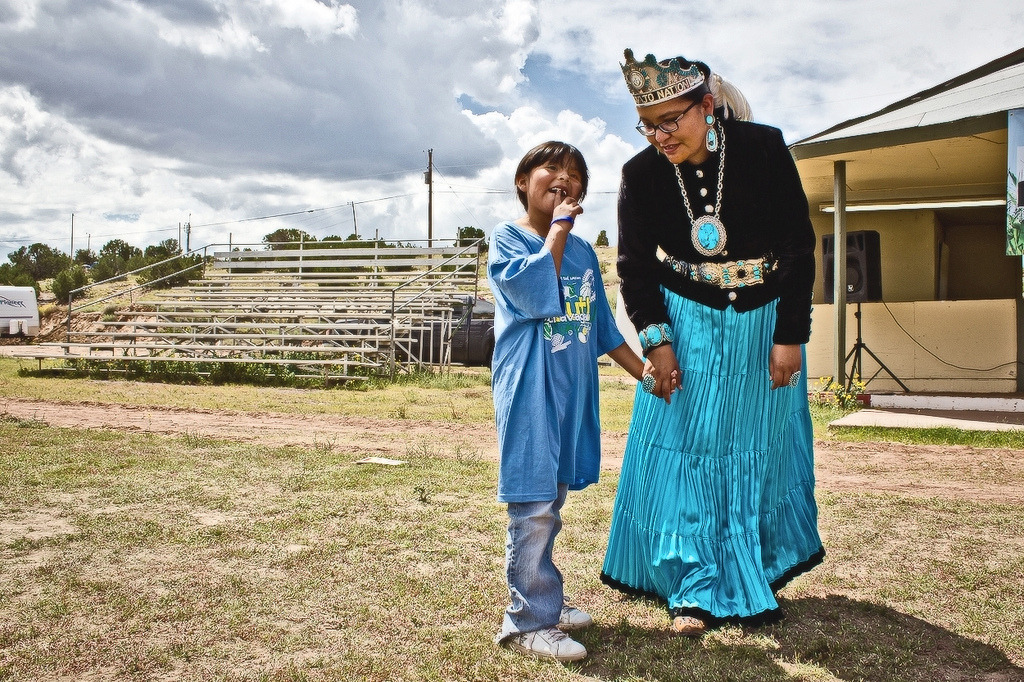 Former Miss Navajo Nation, Winifred Jumbo, speaks to a Navajo girl about her life's ambitions during the 65th Annual Navajo Nation Fair in Window Rock, AZ.