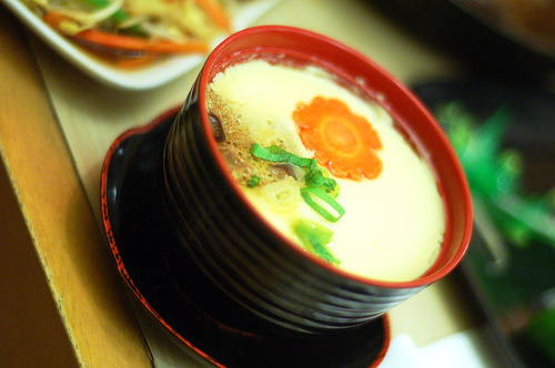 Chawan mushi - an egg custard flavored with soy sauce, dashi, and mirin, with numerous ingredients such as shiitake mushrooms, kamaboko, yuri-ne (lily root) and boiled shrimp placed into a tea-cup-like container.