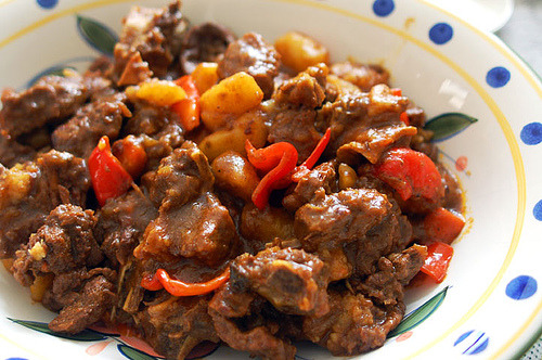 Kaldereta is originally a goat stew made with tomato sauce, potatoes, spices, liver spread, olives, bell peppers and hot peppers, originally adapted from the Spanish during their 300 year occupation of the Philippines.