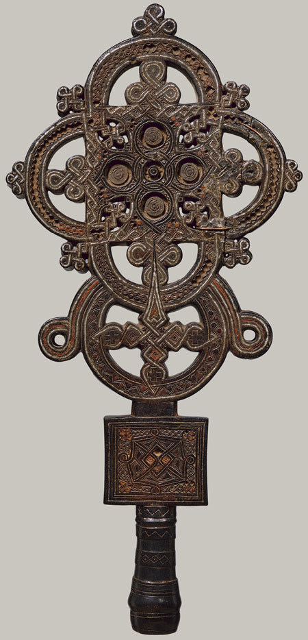 Wood and tin processional cross, ca. AD 1500, Ethiopia.  In the Ethiopian church, the wooden cross is perceived as having been sanctified by the Christ's blood, which conferred upon it the infinite power to heal and bless. - metmuseum.org