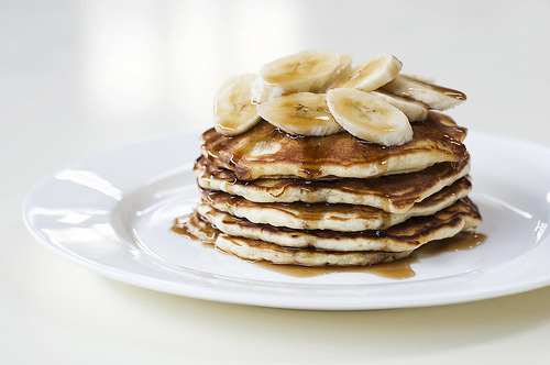 muffintop-less:  Banana Protein Pancakes! Ingredients: 32g quinoa flakes, 192g egg whites, 56g vanilla myofusion (or other protein powder), half of a banana, vanilla extract, grated orange peel. Instructions: Throw all the ingredients together and fry them on a non-stick pan with coconut oil (or a little Pam) Makes 4 big pancakes: 504 kcals, 64g protein, 41g carbs 8 fat and 7.4g fiber (+ your topping of choice)