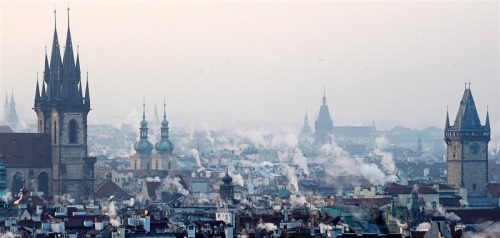 newsflick:  Smoke rises over rooftops in Prague's city center, Czech Republic, on Feb. 3, 2012, during the ongoing cold wave. The temperature dropped nearly to minus 30 degrees Celsius, with at least one fatality reported. The cold in the capital was extreme enough to cause the cracking of tram rails. (source)