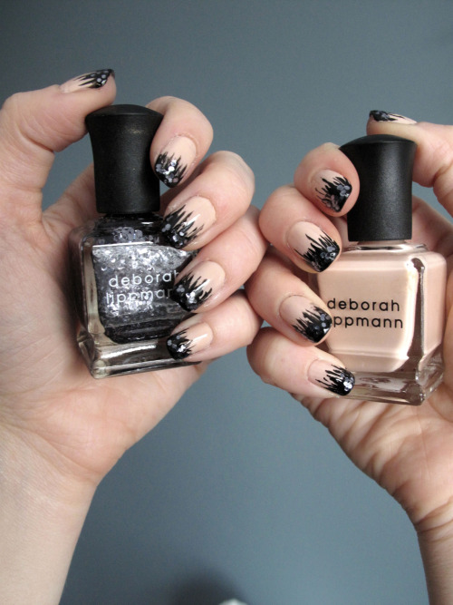 Fancy Nails!! Deborah Lippmann - I'm Not Innocent Deborah Lippmann - I Love The Nightlife Matesse Elite Nail Art Paint - Black OPI - RapiDry Top Coat 1. Apply two coats of I'm Not Innocent to the nails and allow to dry. 2. Apply black Nail Art Paint to the tips of the nails and use the thin point of the brush to make spiked strips down the nail bed. 3. Apply I Love The Nightlife only over the black part of the nail tips. 4. Apply OPI top coat to the nails.